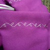 "Close up of the stitching<br /> A set of 12 Fuschia/purple/pink Drawstring bags. Double drawstring closure, satin ribbon. There is a white vine leaf design. 3 1/8"" x 6"". One set available, $5"