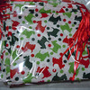 Noel Collection Fabric: Christmas Scotties<br /> Item #11039666<br /> Made of 100% Cotton<br /> <br /> A set of 12 mini drawstring bags with double satin ribbon string closure. Great for christmas or holiday gifts, wedding, shower, or holiday party favors. $3<br /> <br /> **Please note that these are handmade so not all bags will be identical. Sizing and minor imperfections vary slightly bag to bag.**