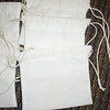 "set of 6 Sew Essentials Bleached Muslin, White. 100% Cotton, Machine wash cool. Hang Dry. Double twine closure. 3 3/8"" x 3 3/8"". One set available, $2"
