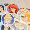 "Close up of all the princesses<br /> 30 Disney Princesses Cake toppers. Already assembled and ready to use. Image is only on one side of the cake topper. Other side is plain white. You can add your own image or saying on the other side. The image itself is raised to create a 3D effect<br /> <br /> <br /> Scalloped white circles, 1 7/16""<br /> Inner picture circle of the princess, 1 1/4""<br /> Images on toppers: 9 Aurora, 1 Cinderella, 10 Ariel, 10 Snow White<br /> <br /> This set will be $4"