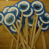 "24 cupcake toppers with 2"" blue scallop rounds with 1 1/2"" inner white circles with cookie monster.<br /> one set available, $5"