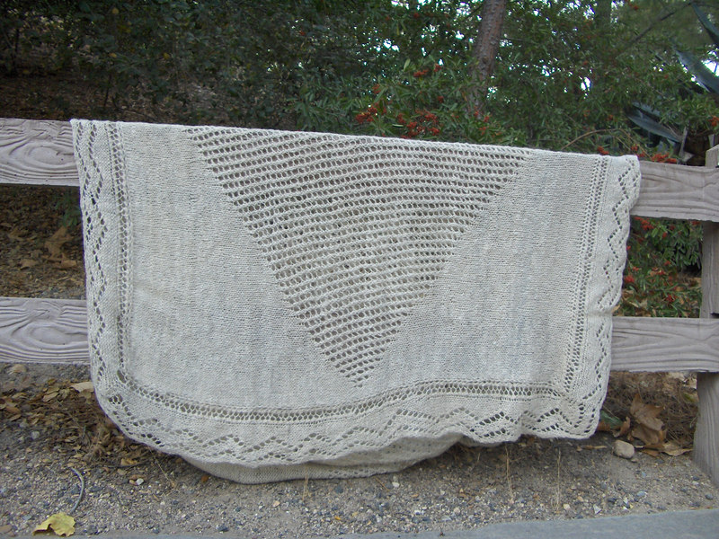 Handspun romney fleece(pretty much the whole fleece)knit into a blanket that ended up measuring @4.5' x6.5'!
