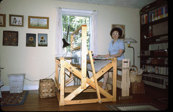 Mary's first loom - delivered by truck from Ohio. The seating bench was designed and built by husband Jim.  The wall hangings and rugs are further examples of Mary's fiber art skills.