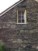Fieldstone farmhouse at Bartram's Gardens, PA- designs under window