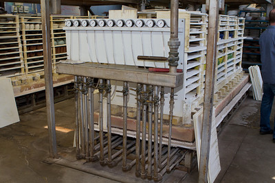 The heat for the kiln is provided by natural gas, with manual adjustments (and indicating gauges) for several burner arrays controlled at the end of the kiln.  Clearly special knowledge is required for successful firings.