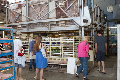 Tim, Jillian, Janet, and Cory checking out a large kiln and its contents.