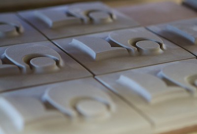 These are pre-fired clay parts, in this case tiles with raised numbers.