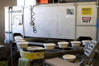 Ceramic clay objects must be baked in a kiln.  This is a continuous kiln where objects are transported slowly through the heated space to be fired.