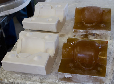 A closer look at complex plaster molds, in this case for a pitcher, and their master molds.