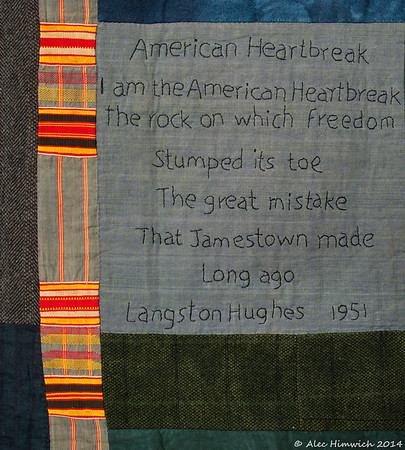 "Detail from  <a href=""http://www.alechimwich.com/Arts-and-Crafts/Heather-Williams-Quilts/i-KVXtrfs"">this</a> quilt. <br><br>   This detail shows an example of <a href=""http://en.wikipedia.org/wiki/Kente_cloth"">Kente cloth</a>.  The patterns and colors in this type of cloth are both significant and symbolic. <br><br> The text reads <br> ""American Hearbreak <br><br> I am the American Heartbreak <br> The rock on which freedom <br> Stumped its toe <br> The great mistake <br> That Jamestown made <br> long ago <br> Langston Hughes <br>1951"""