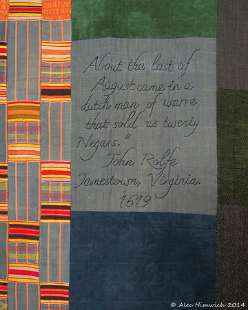 "Detail from  <a href=""http://www.alechimwich.com/Arts-and-Crafts/Heather-Williams-Quilts/i-KVXtrfs"">this</a> quilt. <br><br>  This detail shows an example of <a href=""http://en.wikipedia.org/wiki/Kente_cloth"">Kente cloth</a>.  The patterns and colors in this type of cloth are both significant and symbolic. <br><br> The text reads <br>  ""About the last of  <br> August came in a dutch man of warre  <br> that sold us twenty  <br> Negars.""   <br> John Rolfe <br> Jamestown. Virginia  <br> 1619"""