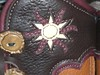 Here is a close-up of an antler crown button and a sun applique.