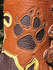 Love those doggies - and all their relations!  Cutout print of coyote paw, out of tobacco button trim, with chocolate boot showing from behind.  Gold underlay surrounds the button trim.  Antler sidecut buttons.