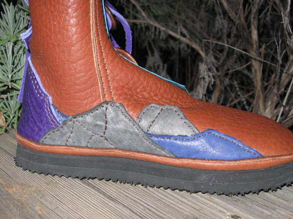 Sherry's boots have a river winding it's way between boulders on the left boot, and....
