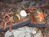 Left - Triple Moon Heel inset, Gold Crescent Moons, White Full Moon with Spiral cutout and Gold Deerskin showing through.<br /> Right - Sun cutout and applique, Orange Goatskin pointy rays, Gold Deerskin curvy rays, Orange Goatskin center with white spiral stiching.