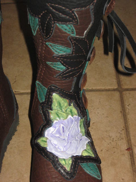 More amazing leather tooling by Bob Winland of Beaders Paradise and Leathercraft.  Sue wanted her tattoo rose duplicated on her moccasins - Bob did a great job!<br /> Sue's boots received a fast dance lesson by heading right to Strawberry Music Festival!<br /> Beaders Paradise and Leathercraft - 530 872-2914, beadersparadise@att.net