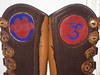 Purple Om, cut out of Red Deerskin, set in Chocolate Button Trim.<br /> Red Lotus Flower, appliqued on Purple Deerskin, set in Chocolate Button Trim.