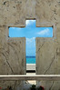 The cross with the ocean behind it really caught my eye. It is located along the shore in Cozumel Mexico.