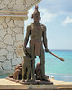 This bronze is located along the shore in Cozumel Mexico.
