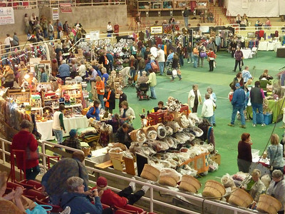 The indoor arena is filled with vendors and shoppers.