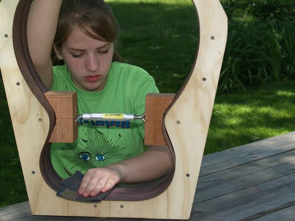 Lydia sanding guitar sides