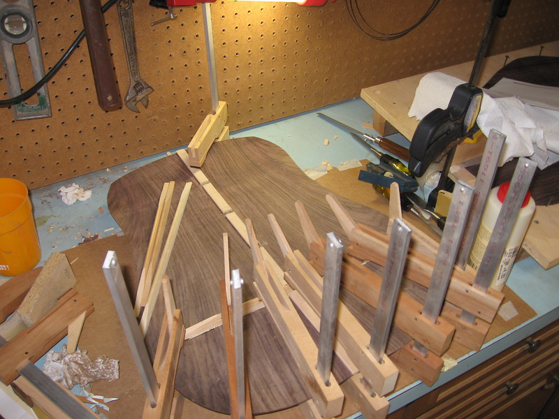 Gluing and clamping the back braces.