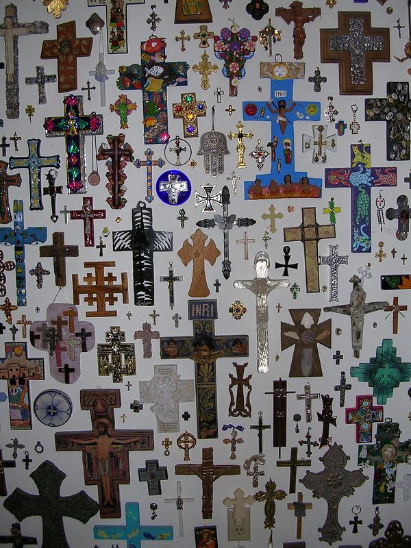 Well over 500 crosses make up this collector's display - not all are from Mexico.  The largest blue cross was made by the Aguilar family of Oaxaca, Mexico and is made of clay.