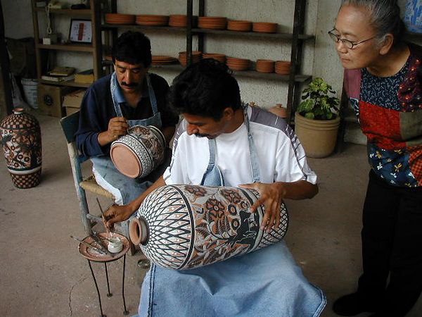 Adult sons of Jose Bernabe demonstrating their skills.  Each can do the entire job, but each specializes in a specific task.