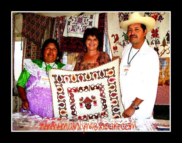 At the 2009 Feria Maestros in Chapala - Enriqueta Cenobio Calixto and Juvenal Bernardino Gómez create beautiful Mazahua miniature embroidery, weaving and a broad variety of crafts. They come from a Mazahua village in the State of Mexico.