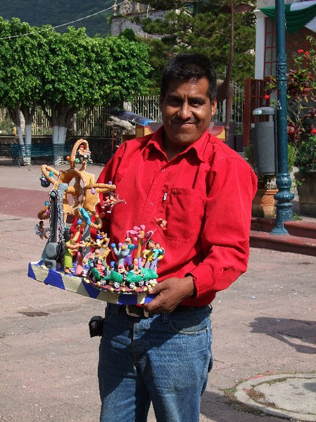 Narciso Lucas Rafael of Ocumicho, Michoacan selling several of his pieces in Ajijic - he and two other artisans came by car for the day to try to make some sales.  Michoacan state has no tourists or retail sales of artisania currently due to continual bad news related to drug cartels.  We purchased this terrific fair scene for 600 pesos or about $52.00.  Narciso speaks very good English, Spanish and Tarascan and hisl phone is 011-52-423-519-9435 - September 2009