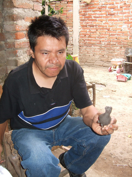 Martin Ibarra of San Juan Evangelista, Jalisco - demonstrating his technique - July 2011 - formed bird whistle in about 5 minutes or less