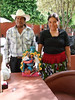 Maria Amalia Nolasco Vargas and her husband Filemon Rafael of Ocumicho , Michoacan selling several of her pieces in Ajijic - she and two other artisans came by car for the day to try to make some sales.  Michoacan state has no tourists or retail sales of artisania currently due to continual bad news related to drug cartels.  We purchased this Saint Michael the Archangel slaying the devil for 1000 pesos or about $80.00.  Her phone is 423-5199-408 - September 2009