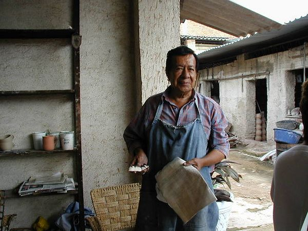 Great Master, Jose Bernabe, at his Tonola workshop where he makes high fired clay objects with the help of all his adult children.  LADAP visited in 2002