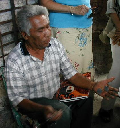 Great Master, Salvador Vasquez, at his home workshop in Tonola demonstrating his skill with clay to LADAP in 2002