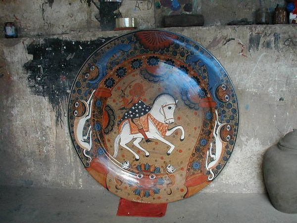 A typical plate or charger created by Salvador Vasquez - notice the naguals around the rim