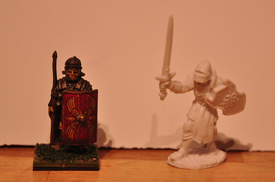 Left: Wargames Foundry metal Roman legionary, 30mm feet to helmet Right: Garrick The Bold, Reaper Bones miniature, 35mm feet to helmet  Both are 28mm scale...