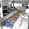 Spring 2009: Colorful Clan Wedding Installation layout, 99 graphic panels of friends and family color coded, velcro LeanBean and I-Pod condom mock-up above