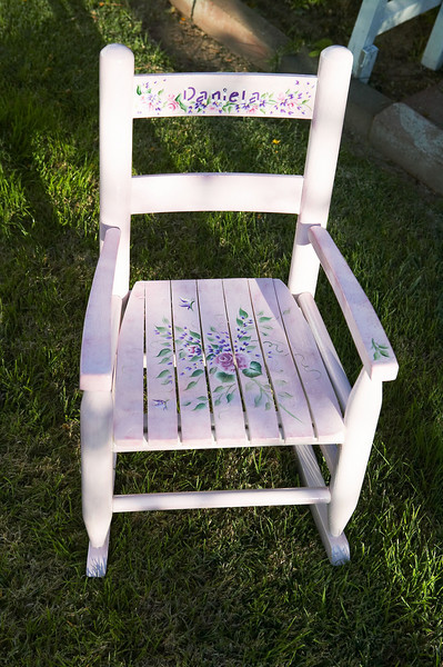Rocking chair made for a young girl as a present. Mom personalized it with the girl's name on the top.