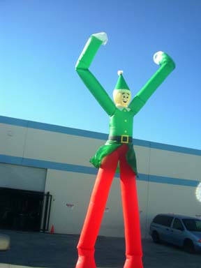 "One of a number of character ""fly guys"" I patterned for Air DD.  This was an 18' tall Elf for the Christmas season.  I would be given a computer rendering of a character the company wanted to create, then I would take the basic ""fly guy"" pattern(body parts, but no face, clothing detail, etc.)and add details, pattern clothing, etc, as was needed to convey the character.  I would then cut the pieces out of fabric and hand them over to the stitchers, answering assembly questions along the way."