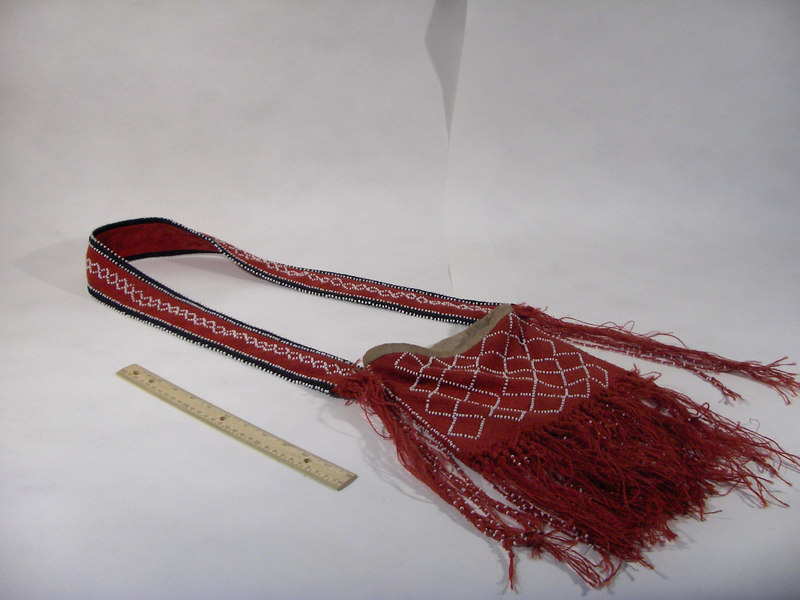 """An example of a shooting bag carried during the 18th century by indians and trappers.  This was made as a """"hero piece"""" for film. It was fully beaded and lined by hand, though using dyed burlap cut on the bias to simulate the traditional """"fingerweaving"""" technique.  It is the property of History for Hire."""
