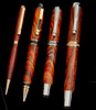 This photo shows difference in size of 4 pen styles. L-R - Standard slimline  - Rosewood, Cigar Pen - Cocobolo, Jr. Statesman II - Cocobolo, Statesman - Chechen