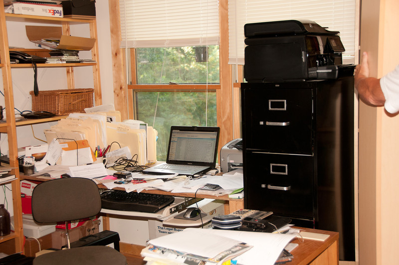 John compares his messy work space