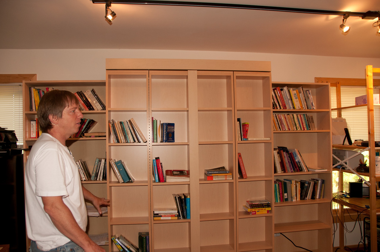 A bookcase wall conceals....