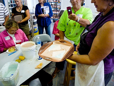 Susan began to demonstrate different ways to apply glaze.