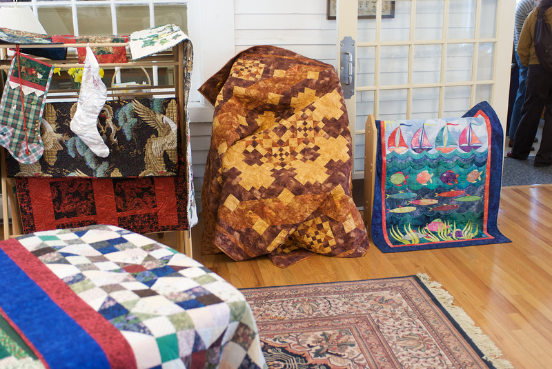 """More of her stuff at the quilt show.  You may have seen the red quilt and the """"Fish"""" quilt at our house.  I also really like the one in the middle with autumn colors."""