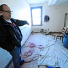 Rollstone Congregational Church Pastor Dave Hanks shows the hole across the room that used to be the church office, where the water damage originated that occurred due to frozen pipes that burst recently.<br /> SENTINEL & ENTERPRISE / BRETT CRAWFORD