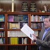 Rabbi Alan Alpert, with the synagogue Agudat Achim in Leominster, talks about the Passover holy day and its preparations at the synagogue on Friday morning. Passover is Monday and Tuesday. During the talk Rabbi Alpert showed off the Haggadah his family had developed for their personal use during their celebration of Passover. SENTINEL & ENTERPRISE/JOHN LOVE