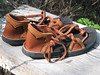 Choices everywhere!  A simple pair of 2 tab sandals, can be juiced up a bit with a little underlay.  This pair of tobacco sandals, has dusk deerskin trim, and an 1/8 of an inch black deerskin underlay.  The soling is thin cushi with Spikeless Golf Vibram.