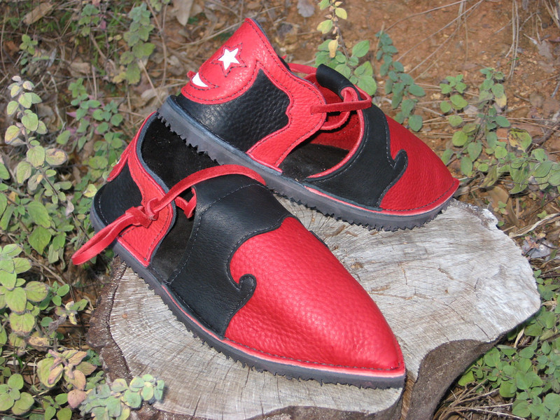 Clown shoes for a very special clown...<br /> Red Bullhide front with Black Bullhide Heel, Black Deerskin 'Fancy' Trim on front, Red Deerskin Trim on Heel with Cutout of Five Point Star and Crescent Moon in White Deerskin, Foam Footbed with Arches, Spikeless Golf Vibram Soling and Pointy Toes!