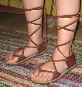 Cypress is 16!  Whoohooooo!  A beautiful 16 - and beautiful feet!<br /> Cypress chose a 2 tab sandal in Tobacco Bullhide, with Redwood Deerskin trim, a lotus flower on the heel of one foot, and an Om symbol on the other.  The soling is Vibram Spikeless Golf.  And she chose to have 'long laces', an option if you would like the laces winding up your legs.